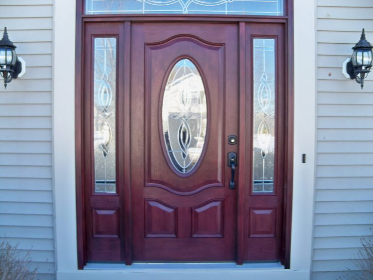 Exterior replacement door installation in Akron, Ohio vinyl sided house