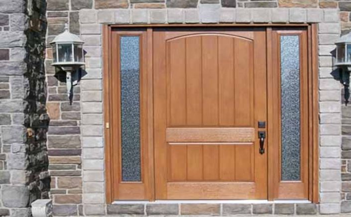 Akron exterior replacement doors installed on a brick home